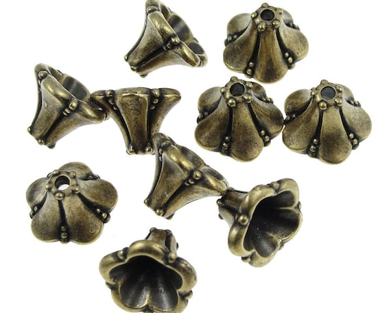 diameter: 9mm length: 8mm two copper plated faceted Tierracast cones #1