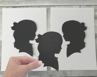 1 extra Silhouette custom portrait in addition to the standard 2 that come with standard silhouette set