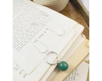 Round jade necklace.