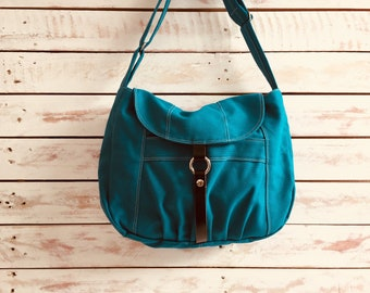 5e5f37c5dabb TEAL Messenger bag with zipper and leather closure
