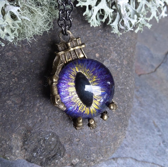 Gothic Steampunk Robot Hand and Evil Eye Pendant