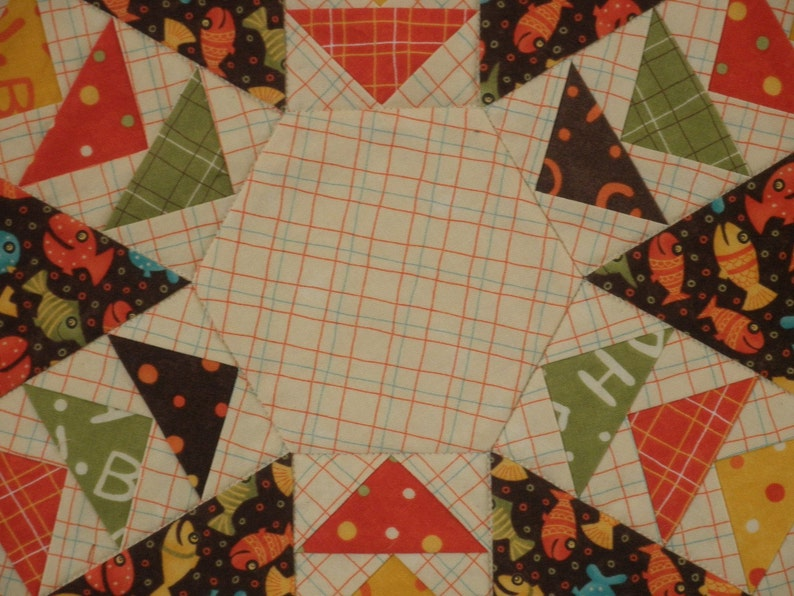 UNTT24 Quilted Flying Geese Table Topper Lollipop Fish