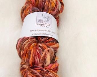 Polwarth Handspun Yarn in Shades of Orange, Mauve and Lilac 103g/142yds