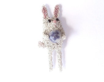Rabbit brooch, shes got the whole world in her hands