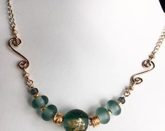 Filled gold with teal hand made lamp glass beads
