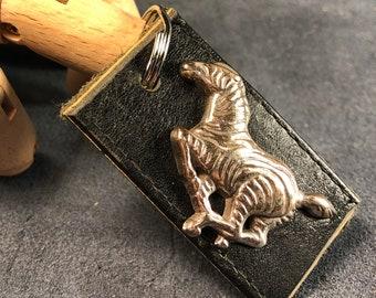 Leather keychain with zebra embellishment