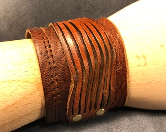 Brown leather cuff with attached  leather piece
