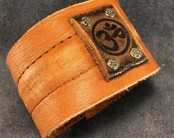 Caramel brown cuff with Om symbol