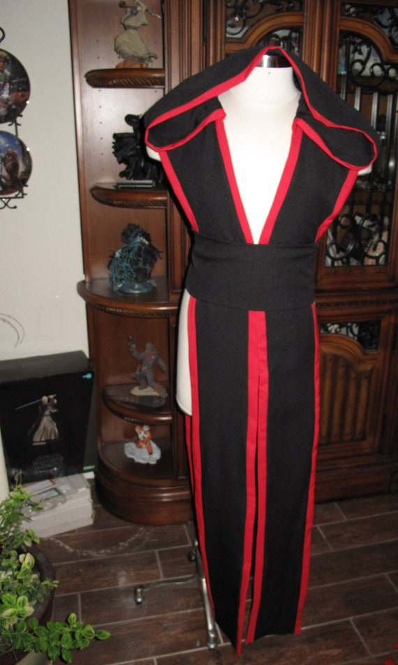 Black sleeveless hooded floor length tabard vest with red border and sash in several sizes