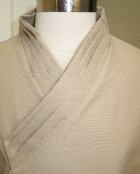 Star Wars Beige Jedi shirt with horizontal tucks on the collar and elastic  or ties around the wrist in 10 sizes XS to 5X