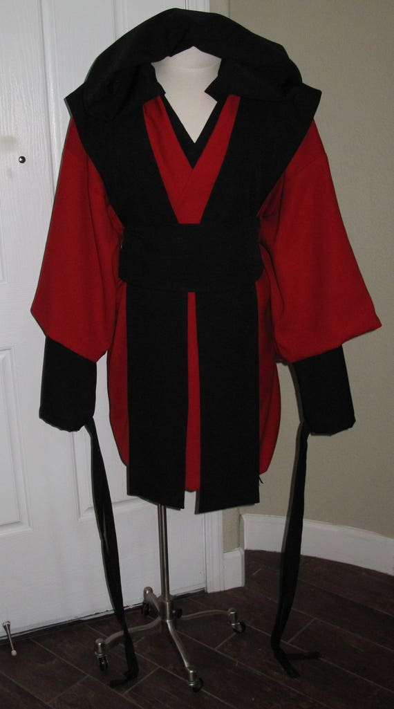 Red Tunic with Black Hooded undershirt with ties around the wrists, Black Tabards and sash, 5 piece costume