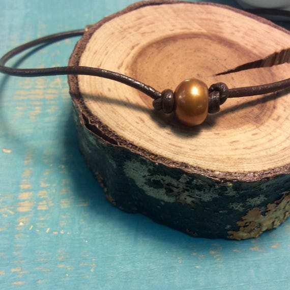 Copper Pearl Choker Necklace on Brown Leather