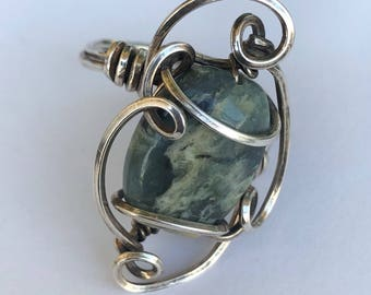 Sterling silver wire wrap ring with gemstone