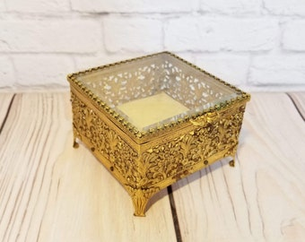 Vintage Gold Toned Filigree Footed Trinket Box With Glass Top Velvet Lining