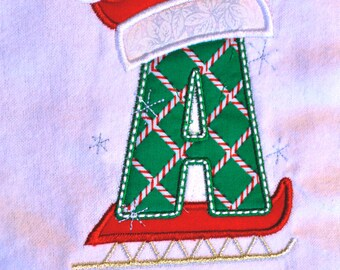 d9aa5871ae6 Christmas toddler shirt with child s initial on a sled with Santa hat