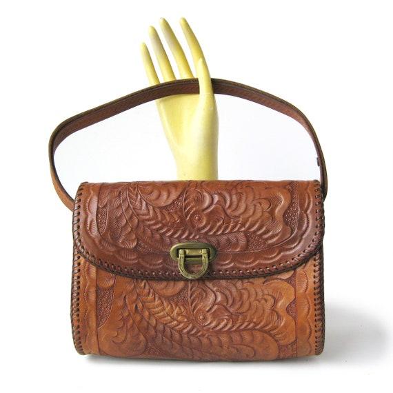 Vintage Tooled Leather Handbag with Horse Shoe Cla
