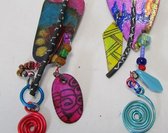 Frida, handpainted geometric shapes, red, blue, turquoise, yellow, spirals, unmatched,  kinetic, sculptural, light and fun