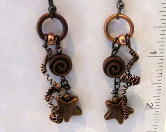 Mona, copper spirals, stars, kinetic,  sculptural, geometric,textured,steampunk,   contemporary, handmade