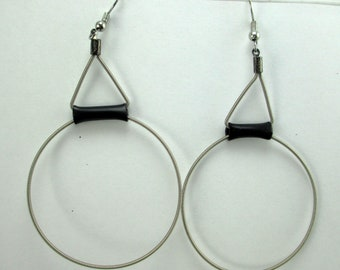 Tolly , silver guitar string hoops,  black rubber, dangle earrings.  sculptural, handmade, contemporary. steampunk