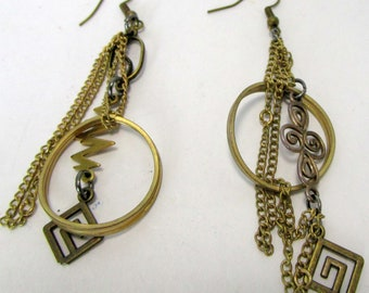 Basia, golden bronze, circle, chains, arrows, spirals, unmatched,  funky, geometric, handmade, casual, kinetic, sculptural, fun,
