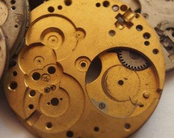 watch movement parts - large circular bases