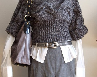 Hand knitted braided shrug in stone gray by Couvert
