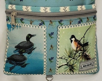 Loon & Chickadee Large Travel Bag that Can Convert to a Backpack. . 4 Exterior Pockets.  2 Zipped.  2 Open.    Free Shipping