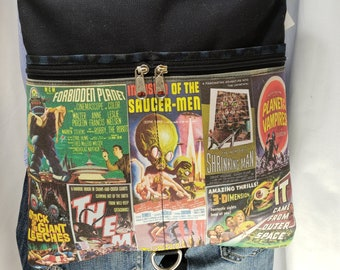 Creature Feature Themed Tablet bag that converts to a backpack.  8 Exterior Pockets.  4 Zipped.  4 Open.  FREE SHIPPING