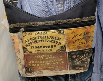 Ouija/Talking Boards Themed Roomy Little Bag.  Six Exterior Pockets.  3 Zipped.  3 Open.  Free Shipping