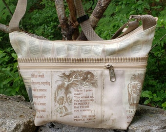 Alice in Wonderland Themed Roomy Little Bag.  Six Exterior Pockets.  3 Zipped.  3 Open.  Free Shipping