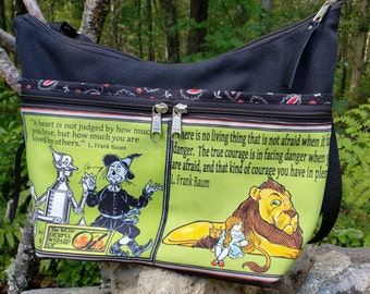 Vintage Wizard of Oz themed Medium Sized Purse with  8 Exterior Pockets.  4 Zipped.  4 Open.  Free Shipping