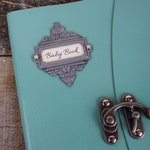 Turquoise leather baby book Peter Pan themed