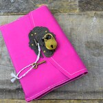 Refillable journal that locks with a lock and key, hot pink leather