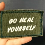 Go Heal Yourself.  Handmade Embroidered Canvas Patch. One of a kind