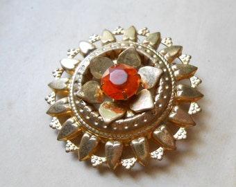 vintage brass flower brooch with topaz rhinestone - costume jewelry