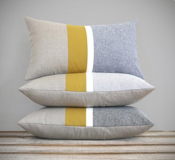Yellow gold lumbar pillow stripe