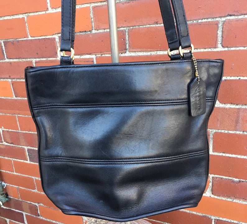 77a16fdcd Coach bucket tote soft black leather. This Coach bag holds | Etsy