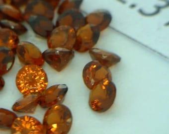 One Dark Red Orange Spessartite Garnet 2.3 mm Faceted Round Average .06 carat