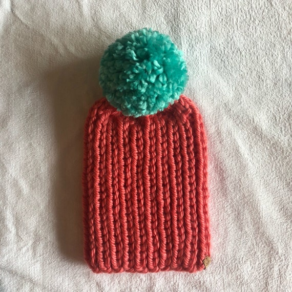 The Anne Beanie in Coral with Sea Foam Pom Pom