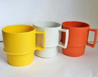 Three 1970s Tupperware Mugs - Vintage Plastic Picnic or Camping Mugs - Stackable Cups in Yellow, Burnt Orange and White