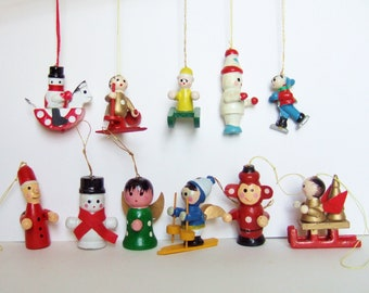 11 wooden christmas decorations of angels santa snowmen skiers skaters etc vintage christmas tree ornaments in painted wood