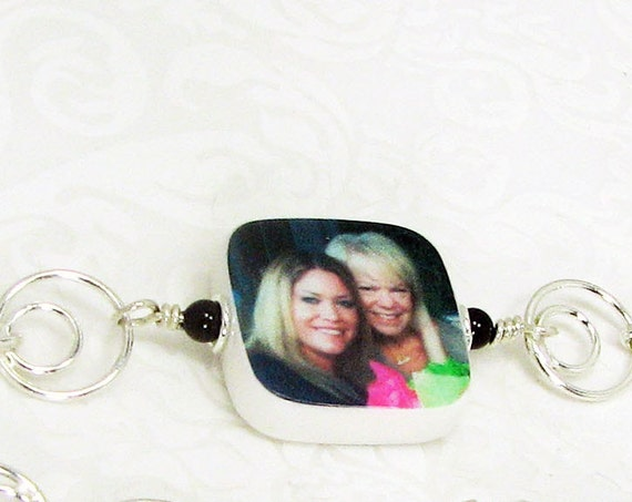 A charm bracelet with a custom, two-sided photo charm - C5RB5