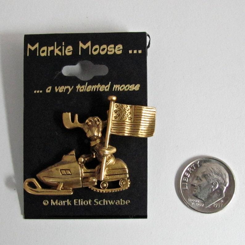 Markie Moose Snowmobile Snow Machine Patriot Flag tac pin gold image 0