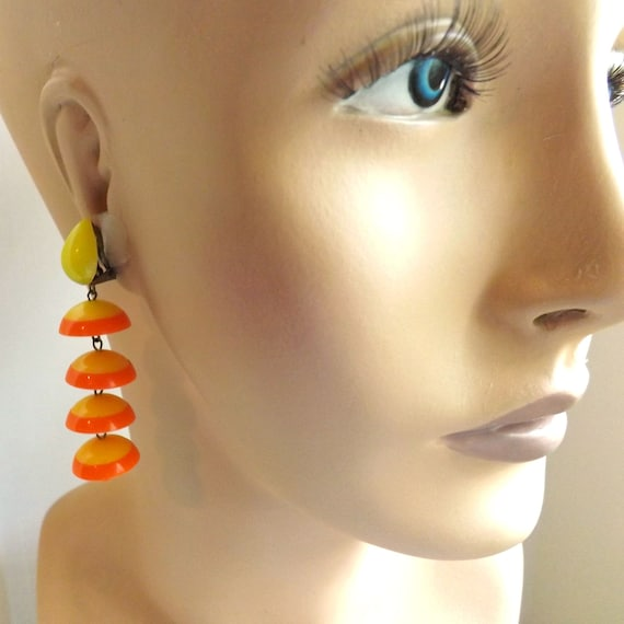 Mod 1960s, go go, yellow and orange plastic dangle