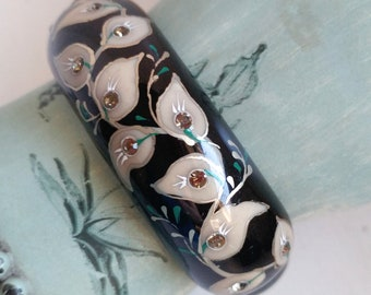 Vintage floral hinged clamper bracelet cuff celluloid black cream gold and teal smoky rhinestones hand painted calla lilies flowers