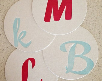 Set of twelve custom monogram letterpress coasters