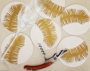Set of eight gold feather letterpress coasters