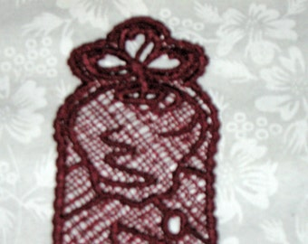 Dark red machine embroidered lace bookmark, apples