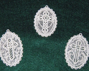 """Three lace white cross medallions, measuring 3 1/2 x 2 1/4"""""""