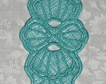 """Machine Lace Bookmark, August Shell, Aqua in color and measures 5 1/2"""" x 2"""""""